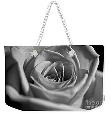 Weekender Tote Bag featuring the photograph Black And White Rose by Micah May