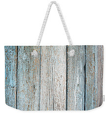 Weekender Tote Bag featuring the photograph Blue Fading Paint On Wood by John Williams