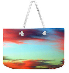 Weekender Tote Bag featuring the photograph Blushed Sky by Linda Hollis