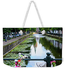 Weekender Tote Bag featuring the digital art Canal And Decorated Bike In The Hague by RicardMN Photography