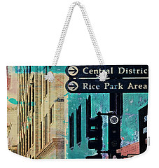 Weekender Tote Bag featuring the photograph Central District by Susan Stone