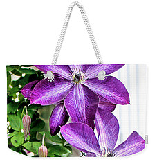 Weekender Tote Bag featuring the photograph Clematis by Kristin Elmquist
