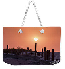 Weekender Tote Bag featuring the photograph Closing The Day by Arik Baltinester