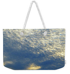 Weekender Tote Bag featuring the photograph Clouds Above  by Lyle Crump
