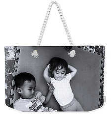 Weekender Tote Bag featuring the photograph Cousins by Jez C Self