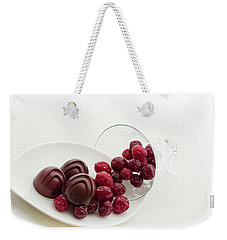 Weekender Tote Bag featuring the photograph Cranberry Chocolate by Sabine Edrissi