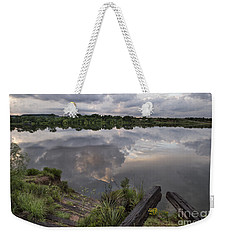Weekender Tote Bag featuring the photograph Dramatic Sunset by Melany Sarafis