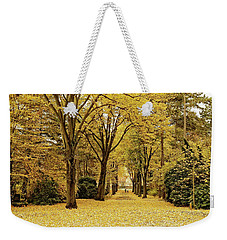 Weekender Tote Bag featuring the photograph Carpet Of Golden Leaves by Ivy Ho