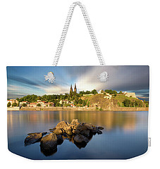 Famous Vysehrad Church During Sunny Day. Amazing Cloudy Sky In Motion. Vltava River, Prague, Czech Republic Weekender Tote Bag