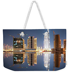 Fascinating Reflection Of Tallest Skyscrapers In Business Bay District During Calm Night. Dubai, United Arab Emirates. Weekender Tote Bag