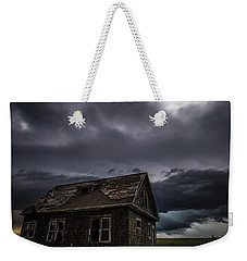 Weekender Tote Bag featuring the photograph Fear by Aaron J Groen
