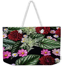 Weekender Tote Bag featuring the photograph Floating Flower Bouquet by Byron Varvarigos