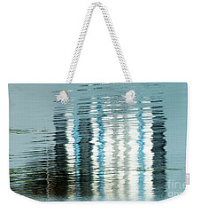 Weekender Tote Bag featuring the photograph Floating On Blue 44 by Wendy Wilton
