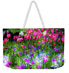 Weekender Tote Bag featuring the photograph Garden Flowers With Tulips by D Davila