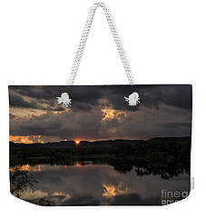 Weekender Tote Bag featuring the photograph Golden Sunset by Melany Sarafis