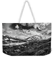 Weekender Tote Bag featuring the photograph Green Carpet Under The Cotton Sky by Dmytro Korol