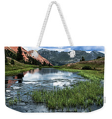 Weekender Tote Bag featuring the photograph Grey Copper Gulch by Jay Stockhaus