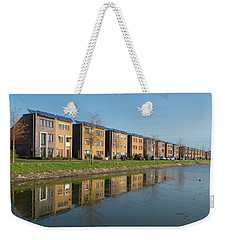Weekender Tote Bag featuring the photograph Houses With Solar Panels by Hans Engbers