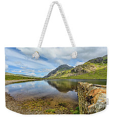 Weekender Tote Bag featuring the photograph Idwal Lake Snowdonia by Adrian Evans