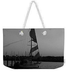 Weekender Tote Bag featuring the photograph In Tatters by Marie Neder