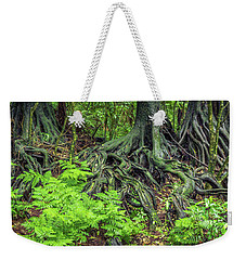 Weekender Tote Bag featuring the photograph Jungle Roots by Les Cunliffe