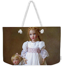 Weekender Tote Bag featuring the photograph Kindhearted Kish Dolls by Nancy Lee Moran