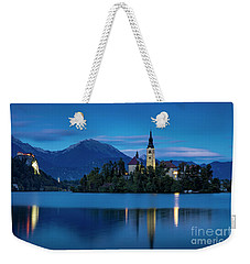 Weekender Tote Bag featuring the photograph Lake Bled Twilight by Brian Jannsen