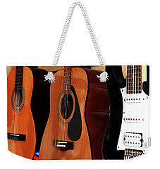 Weekender Tote Bag featuring the photograph Let The Music Play by Baggieoldboy