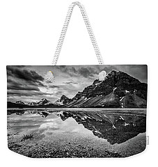 Weekender Tote Bag featuring the photograph Light On The Peak by Jon Glaser