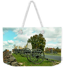 Weekender Tote Bag featuring the photograph Line Of Fire by Paul W Faust - Impressions of Light