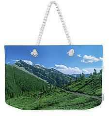 Lone Llama Packer In The Beautiful Bob Marshall Wilderness Weekender Tote Bag by Jerry Voss