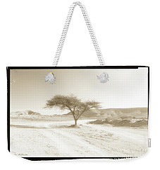Weekender Tote Bag featuring the photograph Lonely Tree by Arik Baltinester