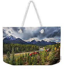 Weekender Tote Bag featuring the photograph Long Train Running by John Poon