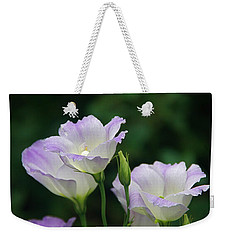 Weekender Tote Bag featuring the photograph Lovely Lisianthus by Byron Varvarigos