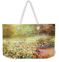 Weekender Tote Bag featuring the photograph Masquerade by Diana Angstadt