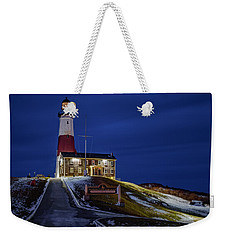 Weekender Tote Bag featuring the photograph Montauk Point Lighthouse by Susan Candelario