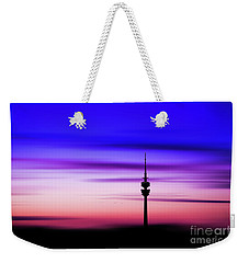Weekender Tote Bag featuring the photograph Munich - Olympiaturm At Sunset by Hannes Cmarits