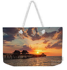 Weekender Tote Bag featuring the photograph Naples Pier At Sunset by Brian Jannsen