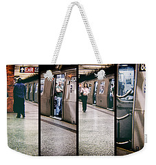 Weekender Tote Bag featuring the photograph New York City Subway Stare by Lars Lentz