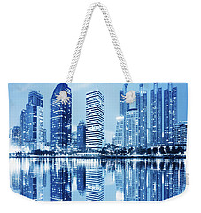 Weekender Tote Bag featuring the photograph Night Scenes Of City by Setsiri Silapasuwanchai
