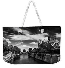 Weekender Tote Bag featuring the photograph Notre Dame Cathedral And The River Seine - Paris by Barry O Carroll