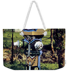 Weekender Tote Bag featuring the photograph Oldenburg Fireplug by Gary Wonning
