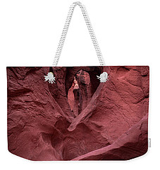 Weekender Tote Bag featuring the photograph Peekaboo by Edgars Erglis