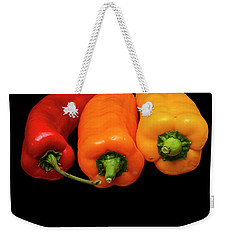 Weekender Tote Bag featuring the photograph Peppers Red Yellow Orange by David French