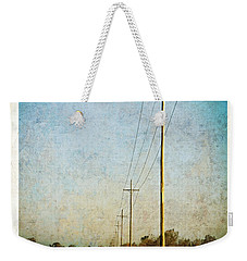 Weekender Tote Bag featuring the photograph Power Lines At Sunrise by Lars Lentz