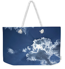 Weekender Tote Bag featuring the photograph Radiance by Megan Dirsa-DuBois
