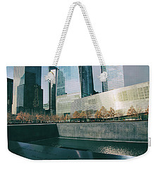Weekender Tote Bag featuring the photograph Reflections Of Sorrow by Jessica Jenney