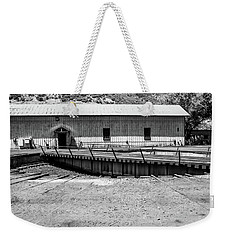 Weekender Tote Bag featuring the photograph Round And Round by Colleen Coccia