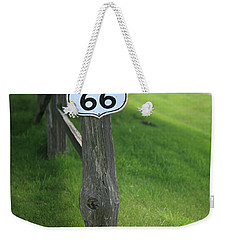 Weekender Tote Bag featuring the photograph Route 66 Shield And Fence Post by Frank Romeo