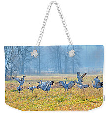 Weekender Tote Bag featuring the photograph Saturday Night by Tony Beck